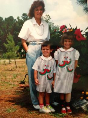 me and my brother with my mom (my brother and I are wearing matching outfits)