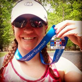 me w/ a medal after completing an olympic distance triathlon