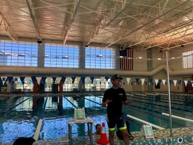 Coach Mark providing instruction at the pool