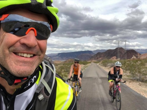 Coach Mark, Amber, and I riding bikes in Nevada