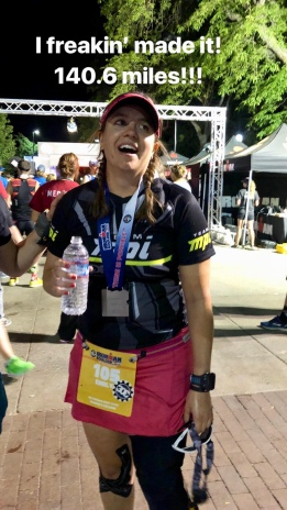 "Me at the finish line looking happy/exhausted with text reading ""I freakin' made it! 140.6 miles!!!"""