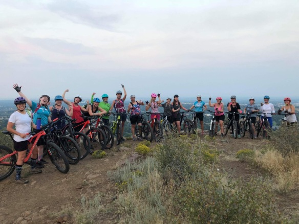 A group of women on top of South Table with their mountain bikes looking happy