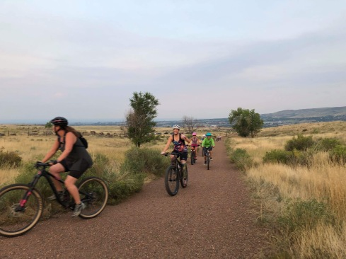 Group of women riding mountain bikes - I'm giving a thumb's up to the camera