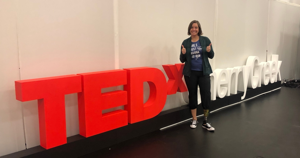 Me standing in front of the TEDxCherryCreek sign giving my signature double thumb's up sign (before we had hair and makeup done)