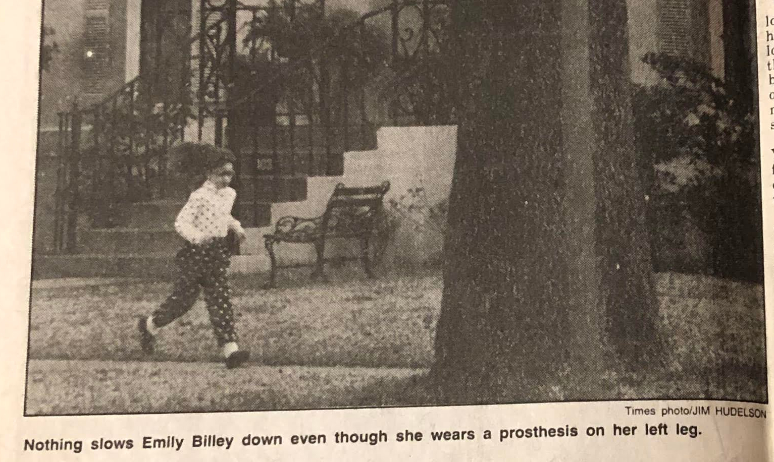 """Photo of me running down the sidewalk in an amazing polka dot outfit with text below that reads: """"Nothing slows Emily Billey down even though she wears a prosthesis on her left leg."""""""