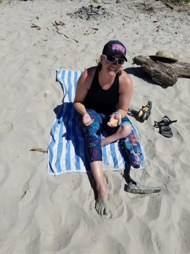 Sitting on the beach with my duct taped foot